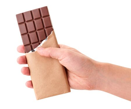 A bar of milk chocolate in hand close-up on a white background. Isolated