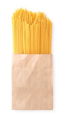 Spaghetti pasta sprinkled from packaging on a white background isolated. The view from top