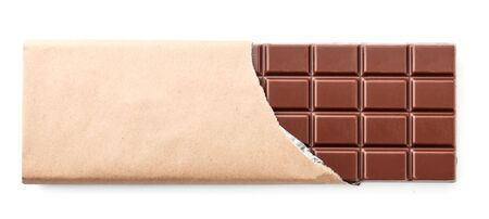 A bar of milk chocolate in a package close-up on a white background isolated. The view from top
