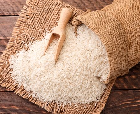 Rice spills out of the bag, background. The view from top