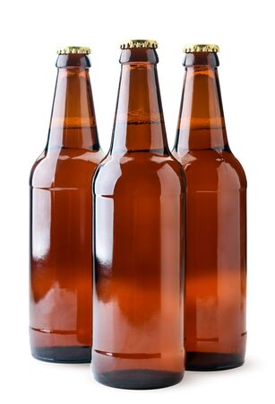 Beer in glass bottles close-up on a white background. Isolated