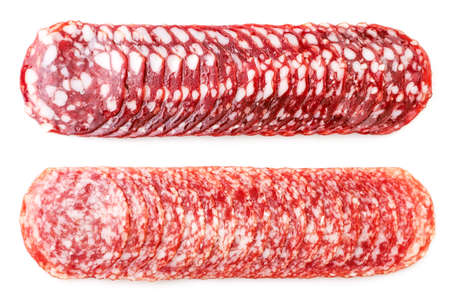 Salami sausage sliced closeup on a white background, isolated. The view from top Reklamní fotografie