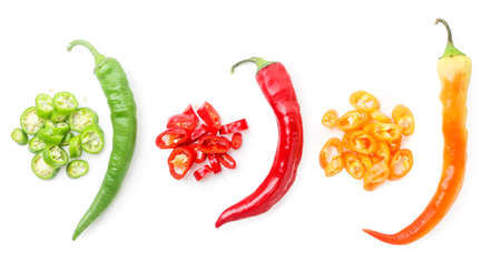 Set of multi-colored bitter peppers whole and sliced close-up on a white background, isolated. The view from top