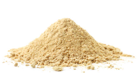 A pile of ground ginger on a white background. Isolated