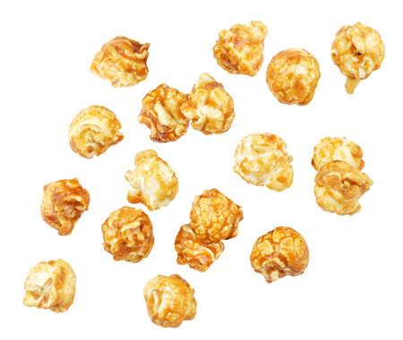 Popcorn caramel drops close-up on a white background, popcorn levitating. Isolated