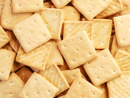 Square crackers close up, crackers background. The view from top