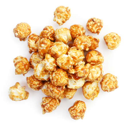 Pile of caramel popcorn close up on white background, isolated. The view from top