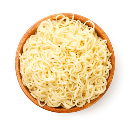 Noodles in a wooden bowl close up on a white background, isolated. The view from top Stok Fotoğraf