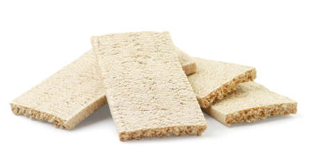 Crispbreads heap close-up on a white background. Isolated