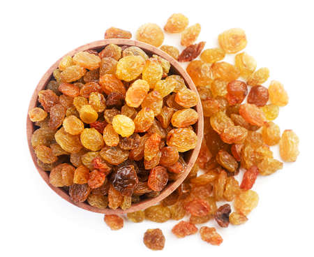 Raisins in a bowl close up on a white background, isolated. The view from top