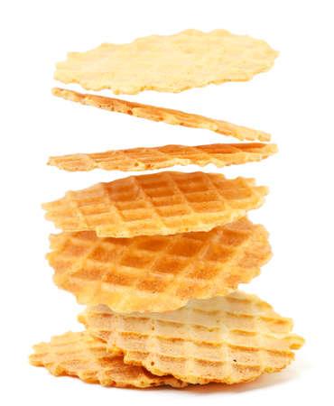 Italian waffles thin and crispy fly on a white background. Isolated levitating wafers 版權商用圖片