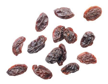 Raisins flies on a white background, levitating. Isolated
