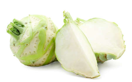 Kohlrabi cabbage whole, half and a piece close-up on a white background. Isolated