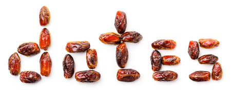 Text from dates fruits close up on white background, isolated. The view from top
