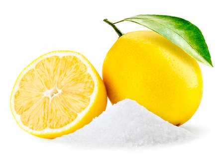 Heap citric acid and whole lemon and half close-up on a white background. Isolated