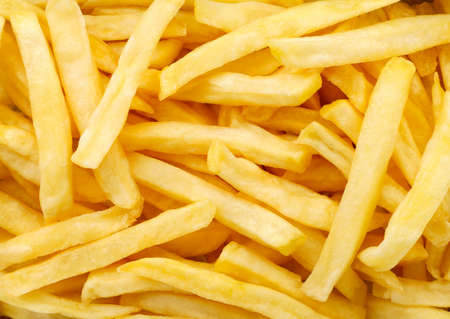 French fries close-up, background. The view of the top