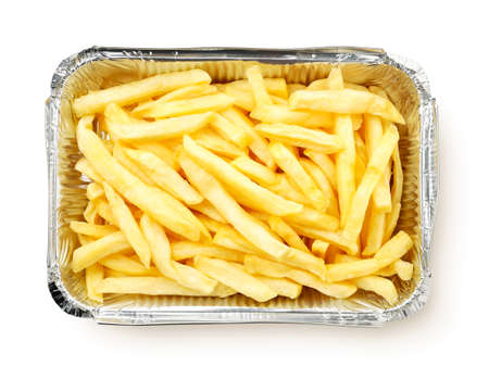 French fries in packaging close up on white background, isolated. The view from top