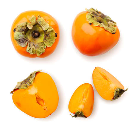 Set of ripe persimmon, half and slices on a white background. Top view.