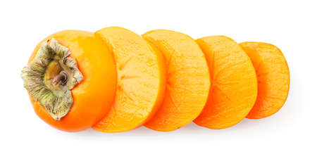 Persimmon cut into pieces close-up on a white background, isolated. Top view Stok Fotoğraf