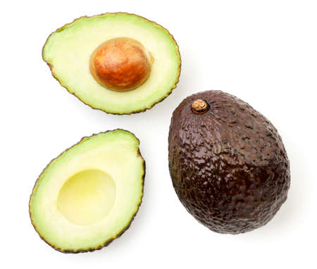 Avocado hass whole and half close up on white background, isolated. The view from top