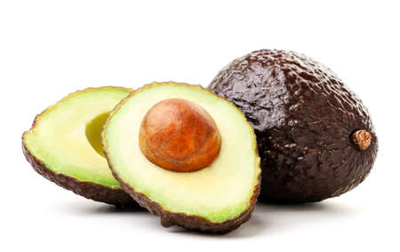 Avocado hass whole and half close-up on a white background. Isolated Zdjęcie Seryjne