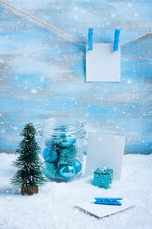Christmas composition with blue decorations, christmas tree, blue gift box and place for text or photos.