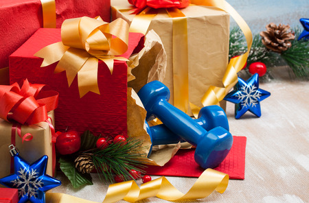 Christmas gifts with blue sport dumbbells and blue star toys for 