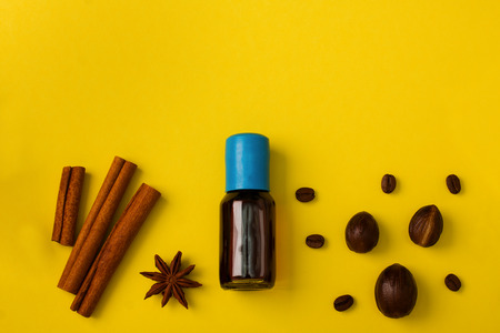Baking background with spices cinnamon anise nutmeg coffee beans and vanilla extract on yellow background. Horizontal orientation, flat lay, place for copy space. 写真素材