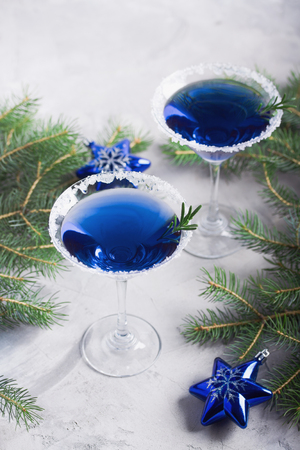 Christmas composition with martini drinks with rosemary and sugar decoration, fir-trees, stars, 