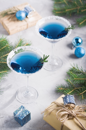 Christmas composition with martini drinks with rosemary and sugar decoration, fir-trees, balls, 