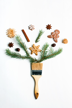 Draw me Christmas creative concept. Christmas new year winter holiday composition wooden brush fir tree branches straw star ball ginger man cookie snowflake spice. Flat lay top view copy space. Stok Fotoğraf - 114580042