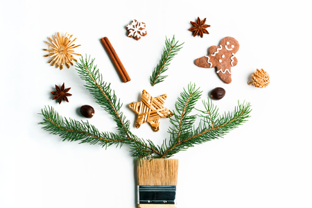 Draw me Christmas creative concept. Christmas new year winter holiday composition wooden brush fir tree branches straw star ball ginger man snowflake cookies spices. Flat lay top view copy space. Imagens