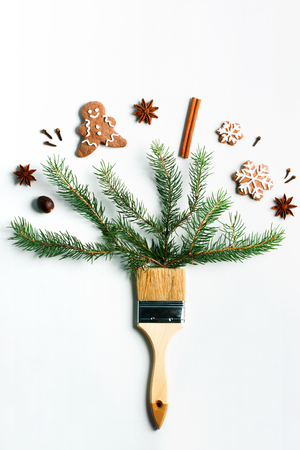 Draw me Christmas creative concept. Christmas new year winter holiday composition wooden brush fir tree branches ginger man snowflakes cookies spices cinnamon anise. Flat lay top view copy space.
