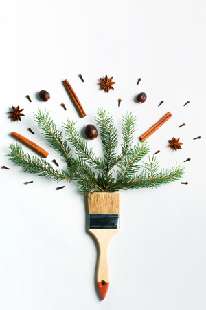Draw me Christmas creative concept. Christmas new year winter holiday composition wooden brush fir tree branches spices cinnamon, anise, nutmeg, cloves. Flat lay top view copy space. Imagens