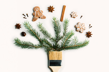 Draw me Christmas creative concept. Christmas new year winter holiday composition wooden brush fir tree branches straw star ball ginger man cookie snowflake spice. Flat lay top view copy space. Imagens