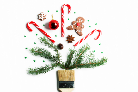 Draw me Christmas creative concept. Christmas new year winter holiday composition wooden brush fir tree branches ball ginger man cookie candy cane spruce snowflake . Flat lay top view copy space.
