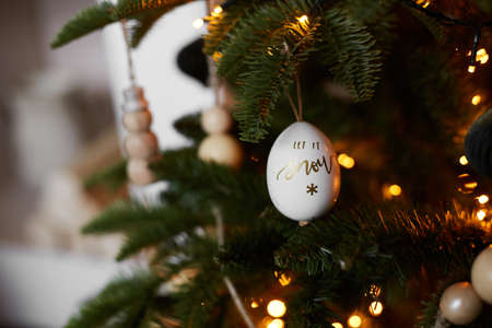 Christmas decoration in shape of egg with lettering Let it snow. Merry Christmas and Happy New Year Stock Photo