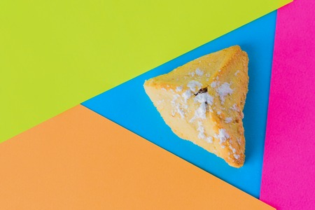 Traditional Jewish Pastry, Hamantaschen, Served During Purim On Modern Colorful Background. Flat lay top-down composition. 版權商用圖片