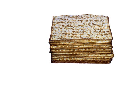 Matzah Passover celebration symbol. Isolated image stack of Matzo on white background. Pile of Matza -Jewish traditional Passover unleavened bread.