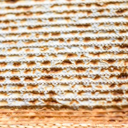 Texture of jewish Passover matzah unleavened bread. Symbols of Passover- Jewish Matza.