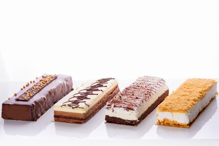 Beautiful Delicious dessert cheesecakes and chocolate cake. Group of four different types of sweet for holiday Shavuot.