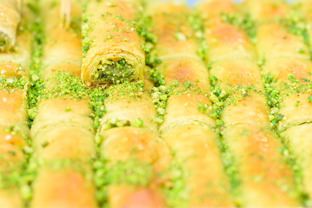 Arabic sweets for celebrate holidays ramadan, iftar,eid on the tray in the market.Selective focus.