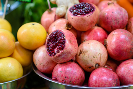 Natural food background. Group pomegranates and oranges for juice and  smoothies in market. Healthy food concept.