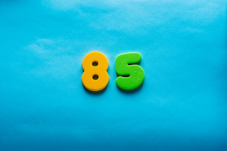85 years old celebrating classic . Colored happy anniversary eighty-five template colorful numbers. Greetings celebrates card. Traditional framed digits of ages. Sale, special prize, % off concept. Stock Photo