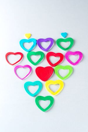 Group of colorful hearts on white background.