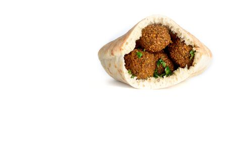Falafel balls in a pita isolated white background. Falafel is a traditional Middle Eastern food, commonly served in a pita.