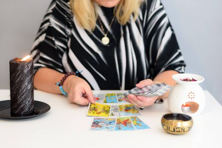 Close up woman hands with tarot cards. Card reading. Divination and clairvoyance.