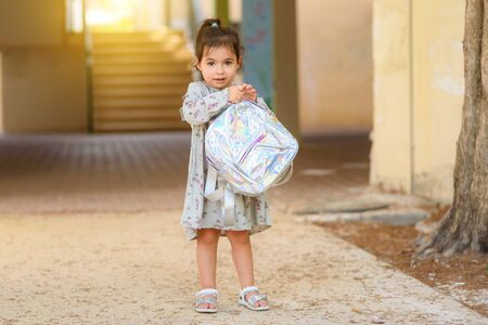 Happy kid back to school. Little girl with backpack go to elementary school. Child of primary school. Portrait of pupil going to school for the first time.