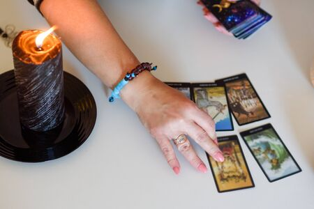 Close up woman hands with tarot cards. Card reading. Divination and clairvoyance. Reklamní fotografie