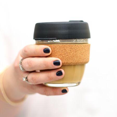 Hand Of A Woman Holding A Reusable Glass Coffee Mug. Eco Friendly, Zero Waste Concept.